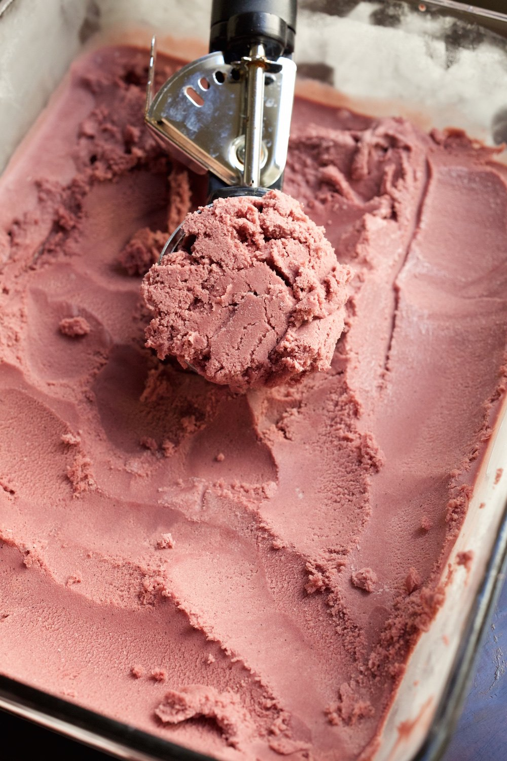 Red wine ice cream being scooped
