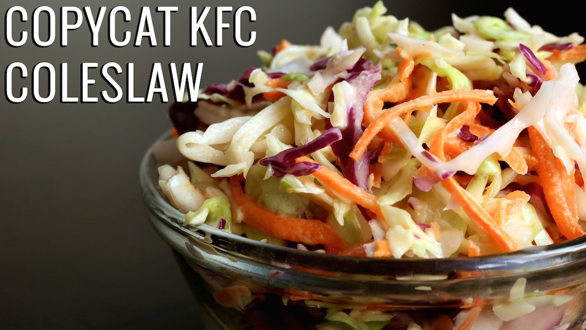 """A small glass bowl filled with coleslaw on a black background. Text reads """"Copycat KFC Coleslaw""""."""