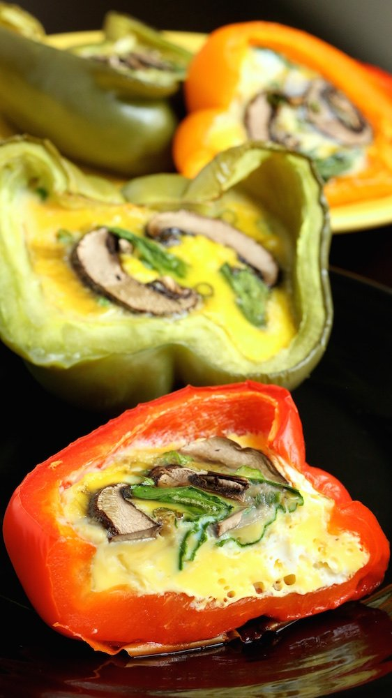 Spinach, Mushroom, & Egg Stuffed Bell Peppers on a black plate