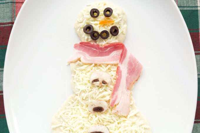 Snowman Pizza made with ranch, bacon, olives, and mushrooms. Perfect for Christmas movie night!
