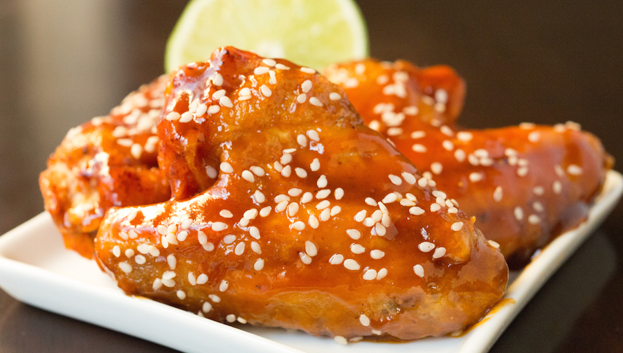 Chicken wings fried to perfection then covered in honey sriracha lime glaze.