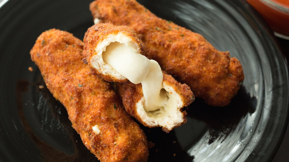 Mozzarella Stick Chicken Fries - Mozzarella sticks are wrapped in seasoned ground chicken, then breaded and deep fried.
