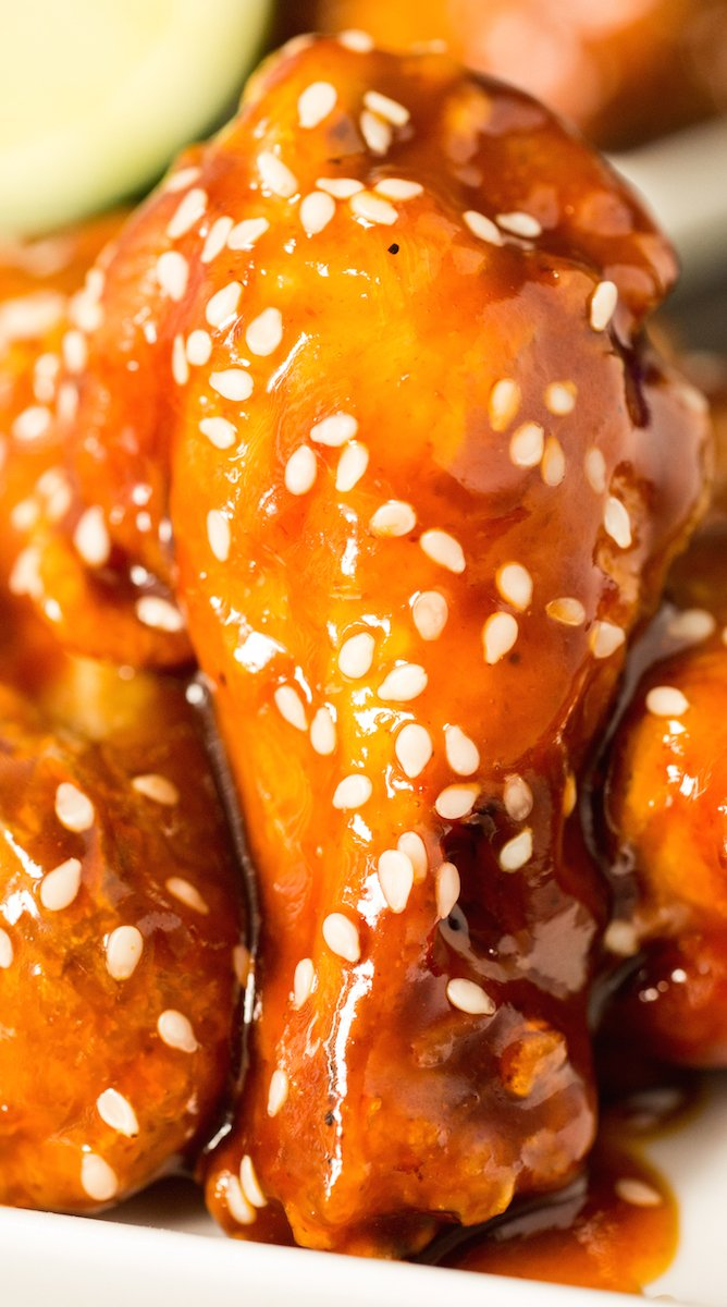 Chicken wings fried to crispy perfection, then covered in a sweet and spicy honey Sriracha lime glaze.