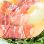 Sweet melon wrapped in salty prosciutto then topped with creamy burrata. Easy, low-carb lunch.