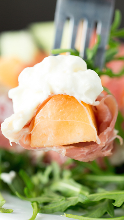 Cantaloupe & honeydew melon wrapped in prosciutto then topped with creamy burrata and served on a bed of arugula.