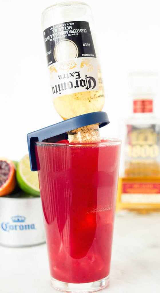 Blood Orange Coronitas made with fresh juice, lemongrass simple syrup, 1800 tequila, and coronitas. Happy Cino de Mayo!