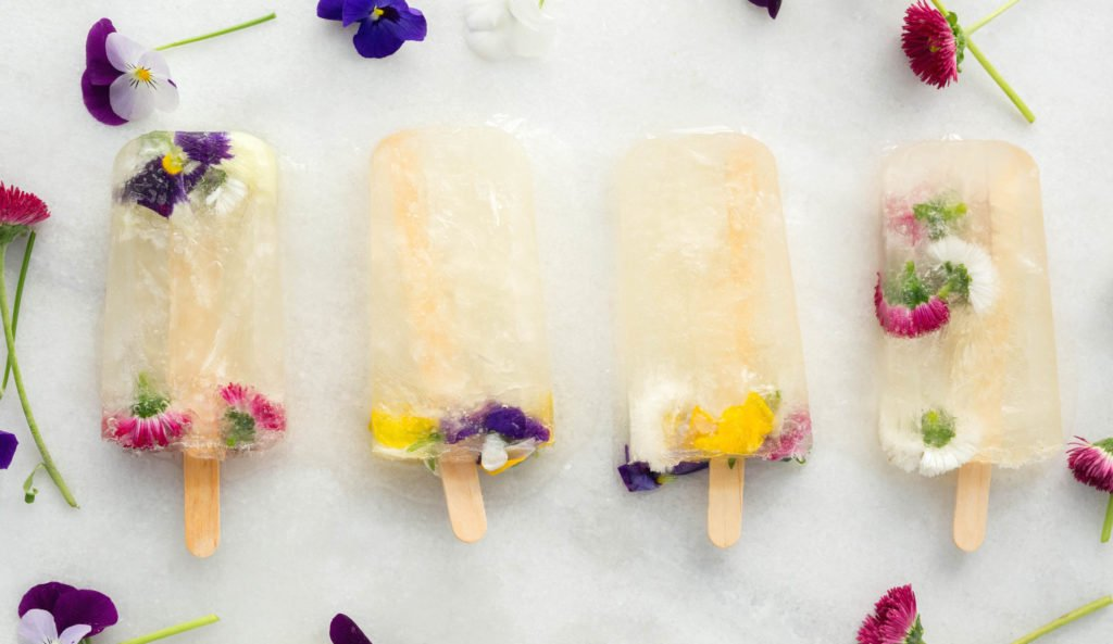 Champagne Popsicles made with St. Germain and Edible Flowers.
