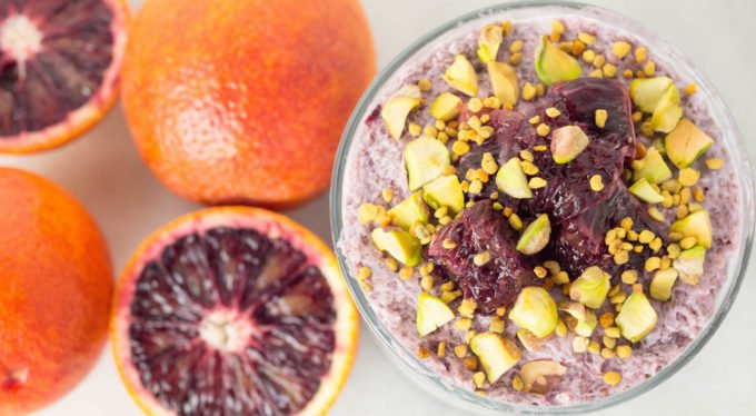 Blood Orange Chia Seed layered with Vanilla Overnight Oats & topped with pistachios and bee pollen to make a healthy breakfast parfait.