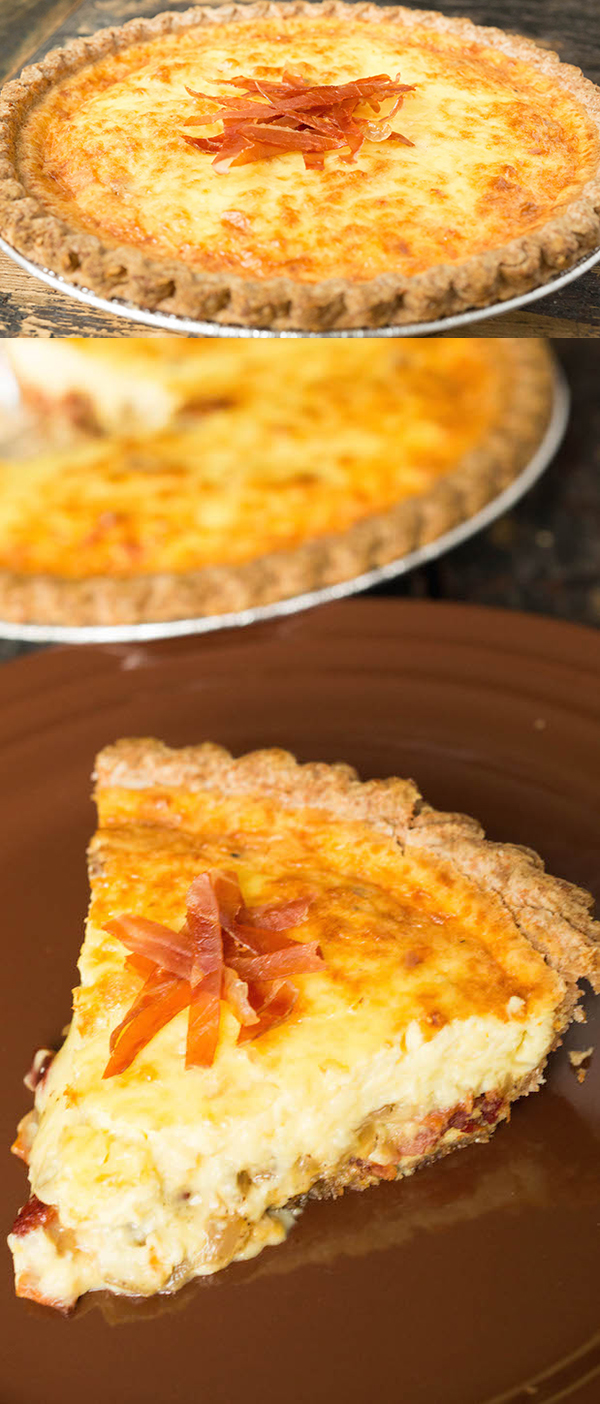 Duck Egg Quiche stuffed with bacon and shallots, topped with prosciutto strips.