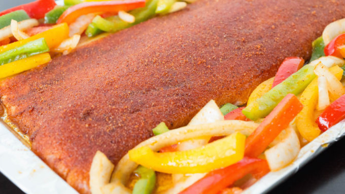 This fajita seasoned salmon & peppers recipe is made in one pan for easy clean up.