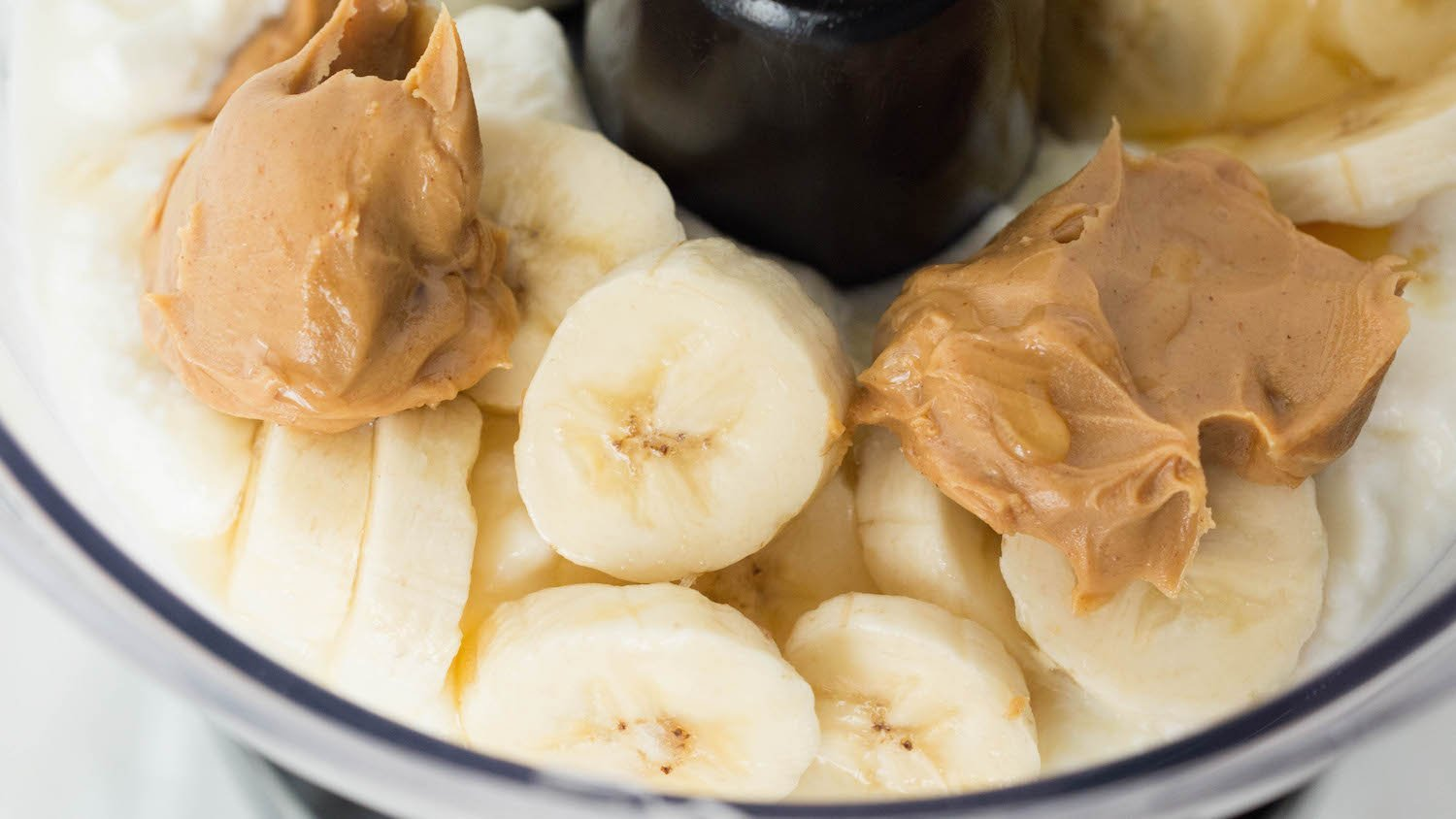 Blend all the ingredients together to make yogurt peanut butter banana dog treats.
