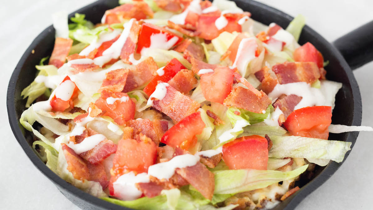 BLT Waffle Fries - Waffle cut fries covered in mozzarella, ranch, shredded lettuce, bacon, and tomatoes.