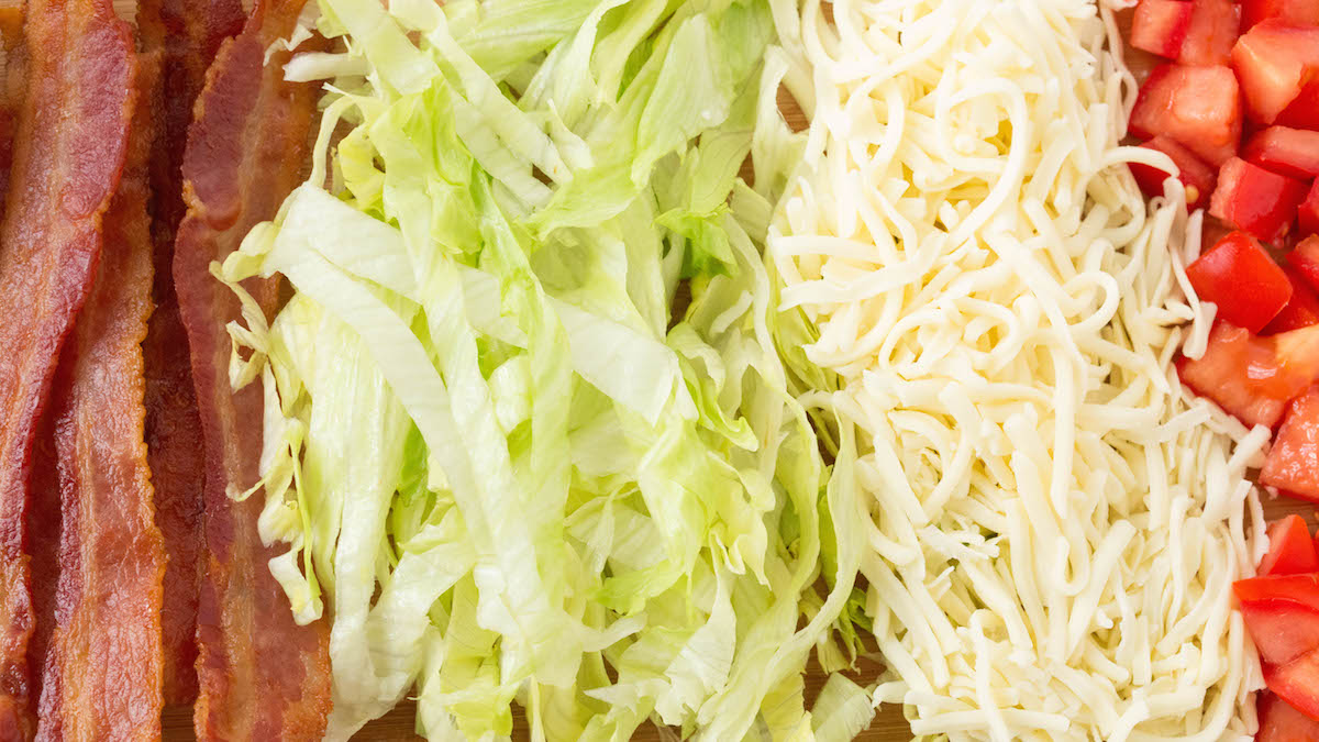 Ingredient for BLT Waffle Fries: Bacon, Lettuce, Mozzarella, and tomato.
