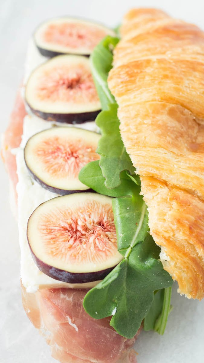 A croissant sandwich recipe made with figs, blue cheese, prosciutto, and arugula.