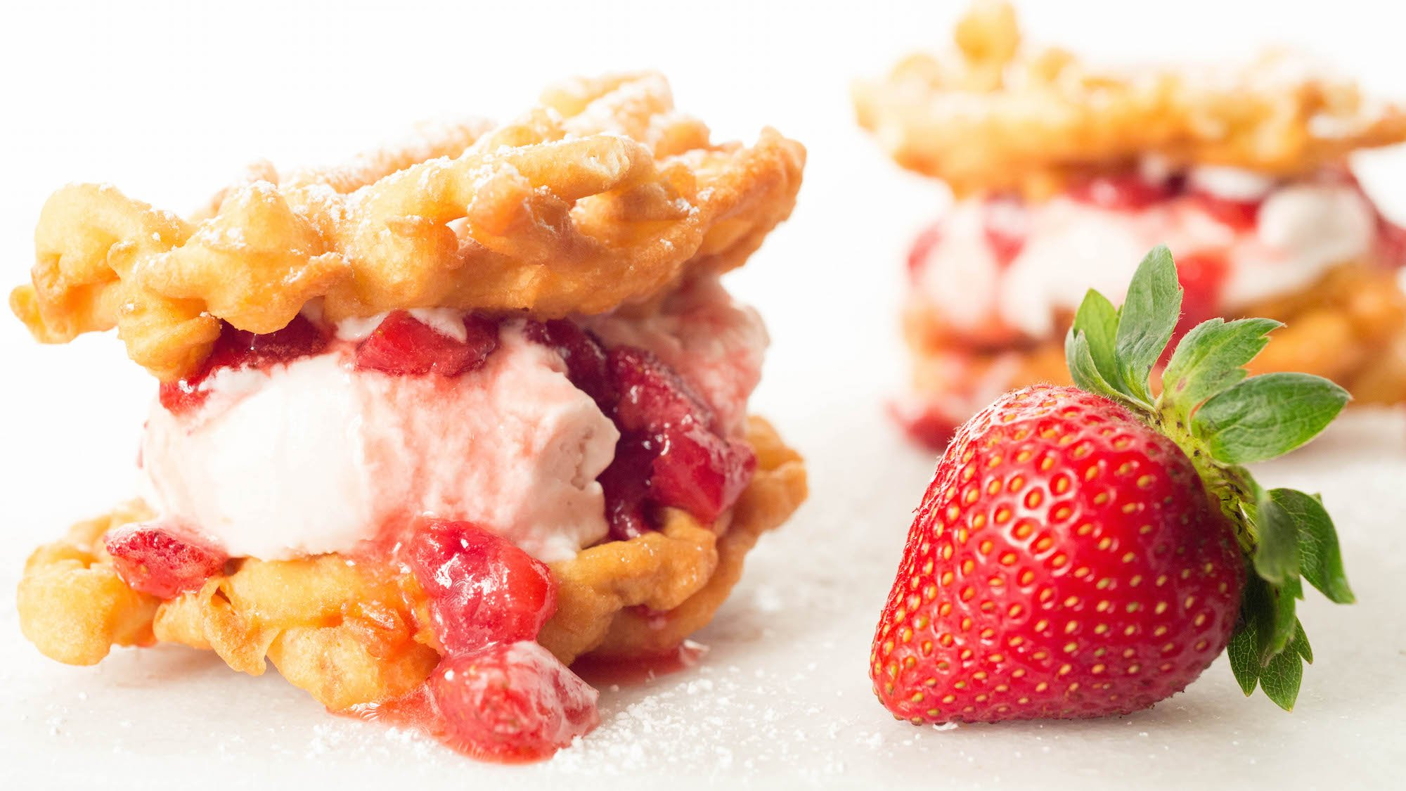 Homemade Funnel Cake Ice Cream Sandwiches with Roasted Strawberry Buttermilk Ice Cream and fresh Strawberry Syrup