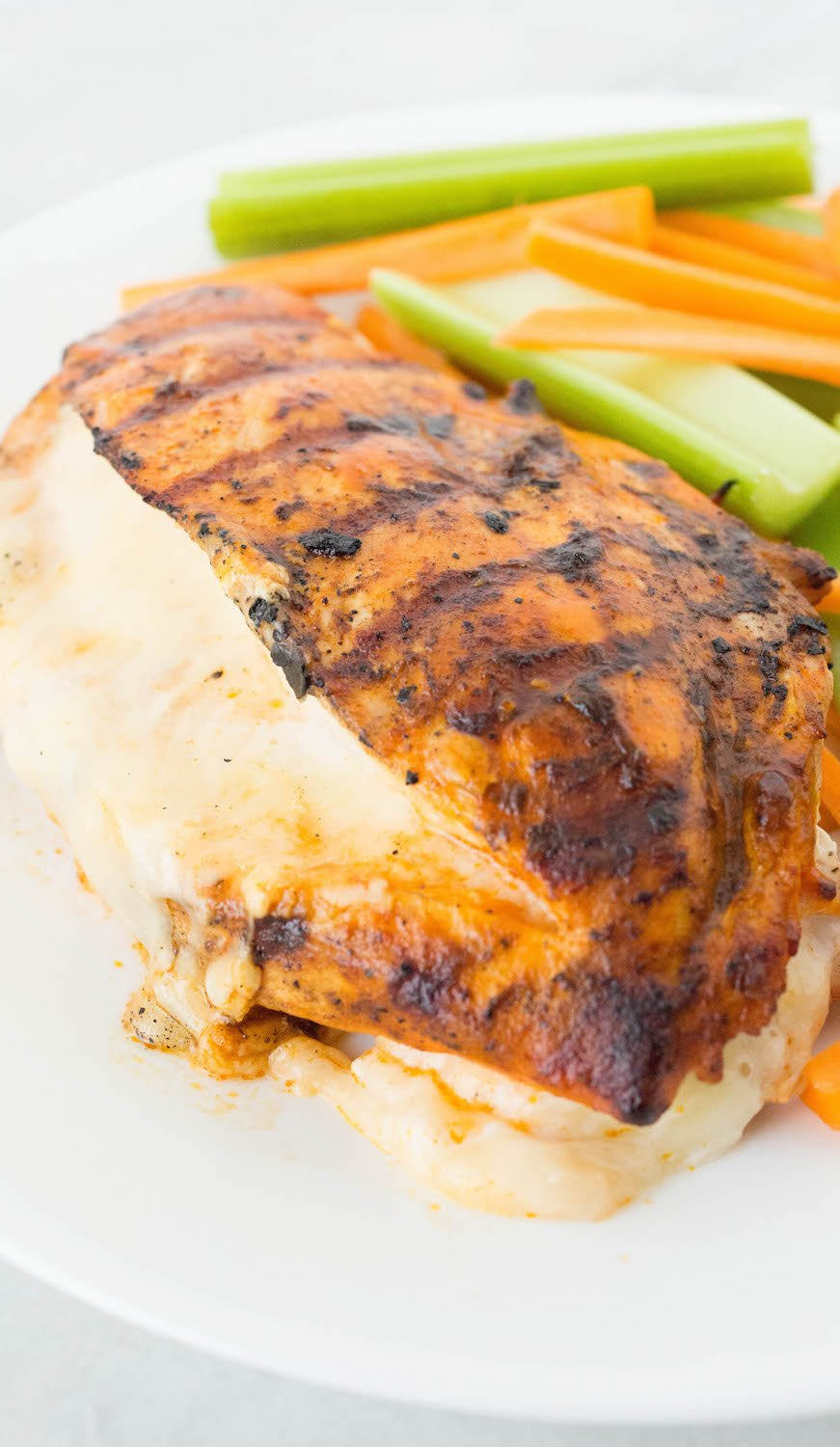 Take grilled chicken to a whole new level by brushing it with buffalo sauce, stuffing it with cheese, then grilling it to perfection. (Low carb)