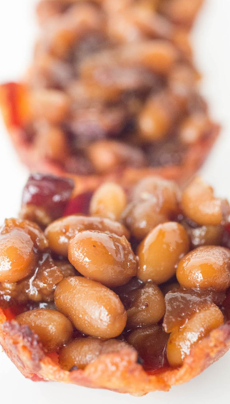 These homemade baked beans are the perfectly blend of sweet and savory, with a hint of heat. Served in mini bacon cups.