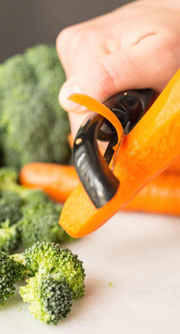 Shaving carrots for Halloween Vegetable Pizza