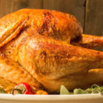 This flavorful Cajun Turkey recipe involves injecting Sriracha beer into the meat.
