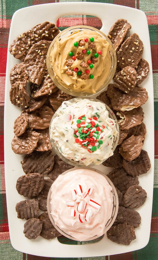 Christmas Dessert Dip Platter with Christmas Cookie Dough Dip, Gingerbread Dip, Peppermint Fluff Dip with Chocolate Wavy Lay's Chips For Dipping.