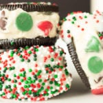Oreos stuffed with Christmas cookie dough, then dipped in white chocolate and garnished with sprinkles. Makes a great edible gift or Christmas party dessert.
