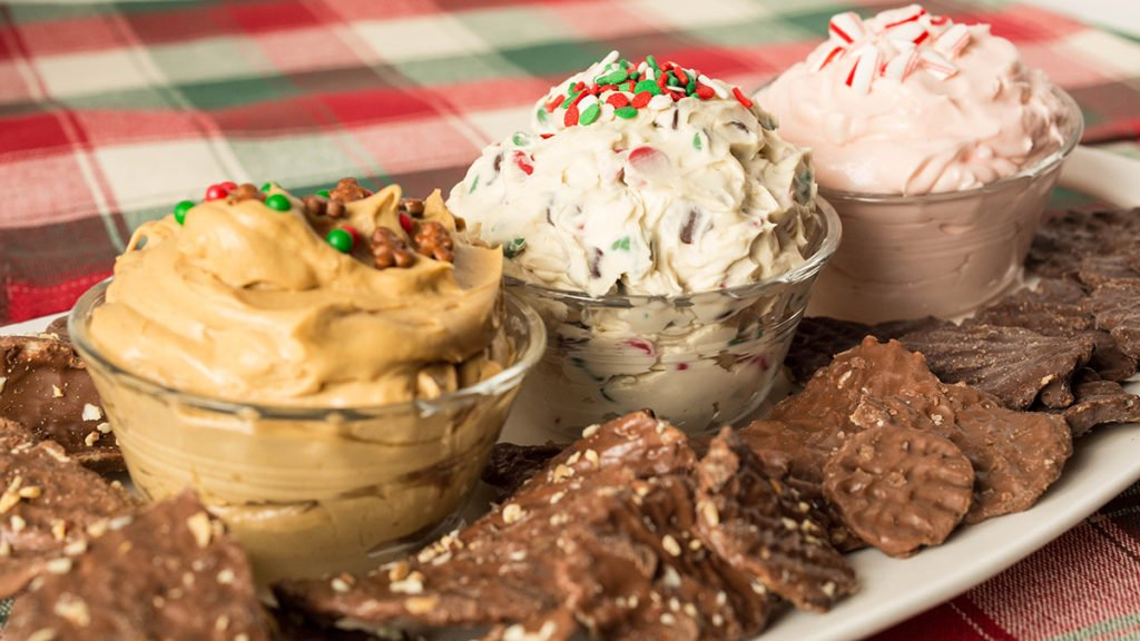 A trio of dessert dip recipes: Christmas Cookie Dough Dip, Gingerbread Dip, and Peppermint Fluff. Served with Chocolate Wavy Lay's Potato Chips.
