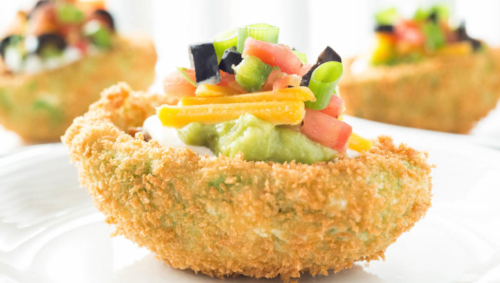 Spicy 7 Layer Dip Stuffed Deep Fried Avocados - The perfect game day appetizer recipe.