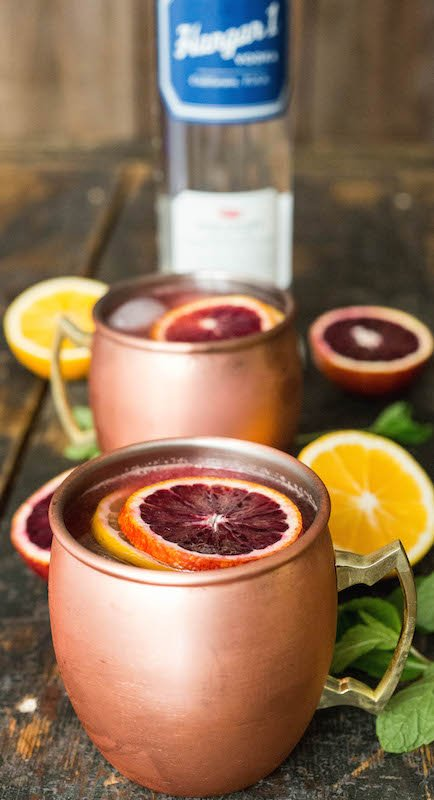 These moscow mules are infused with fresh blood orange & Meyer lemon juices for a seasonal cocktail treat.
