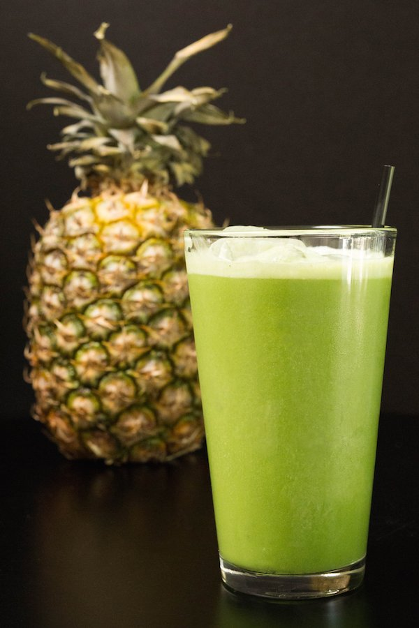 Homemade copycat Starbucks Matcha Pineapple Drink on a black background