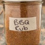 BBQ spice rib in a glass mason jar on a wood background