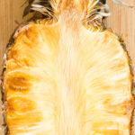 Medium shot of a half pineapple that has been smoked in a meat smoker