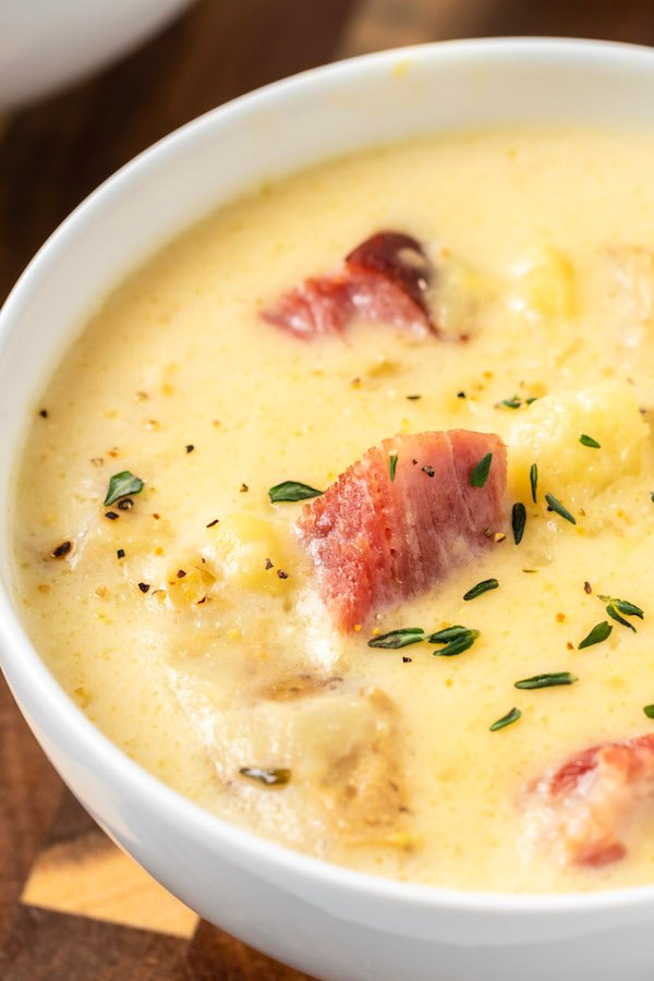 Closeup of a white bowl thats filled with Instant Pot ham and potato soup.