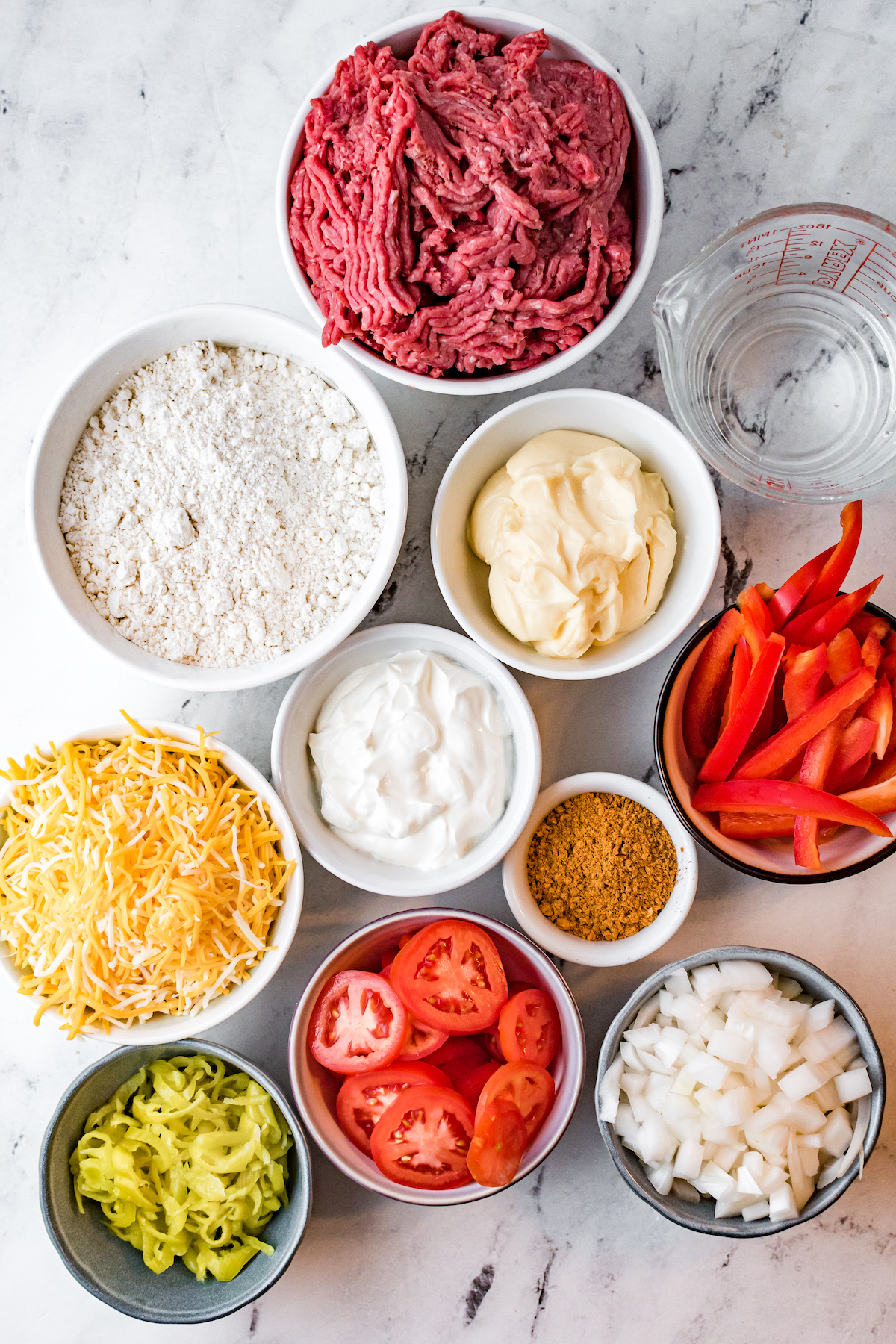 Overhead view of bowls filled with the raw ingredients to make John Wayne casserole.